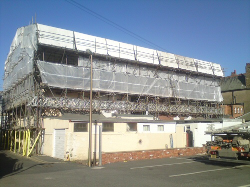 Temporary roof and access scaffolding erected to a terrace of four hotels in Blackpool