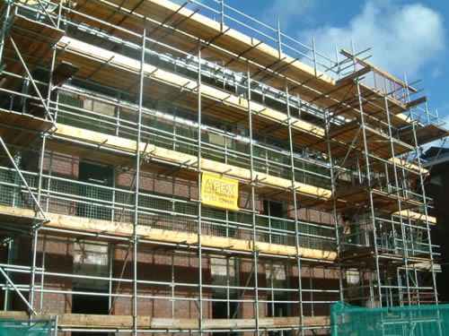 Scaffolding for extension of existing brick-built office blocks at Parkway, Manchester